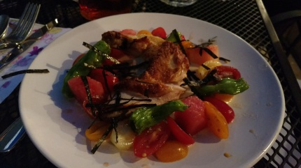 Free range chicken with tomatoes, watermelon, and shishito peppers.